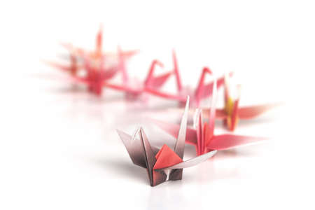 A queue of origami birds on a white background Stock Photo - 3610414