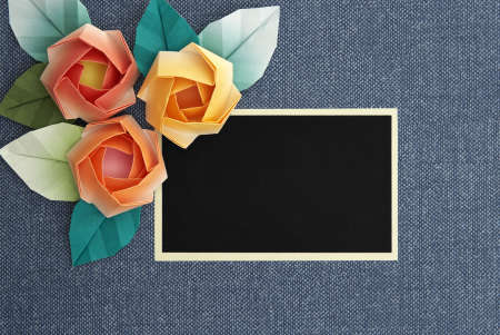 3 origami roses decoration on a greyish blue background. 3 roses traditionally represent the 3 words �I love you�. photo