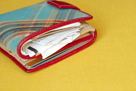 Close-up of a wallet which contains some cards and lots of receipts   Stock Photo