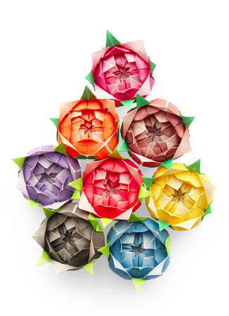 8 origami roses on a white background arranged in a shape of a pear or a tear drop photo