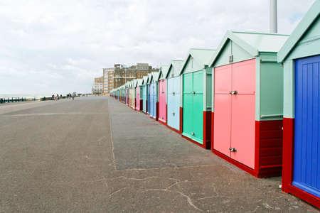 Colourful beach huts along Brighton Beach (Southern coast of Britain)
