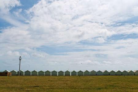 A roll of beach huts along Brighton Beach (Southern coast of Britain)   Stock Photo