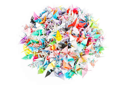 A circle pile of paper cranes isolated on a white background