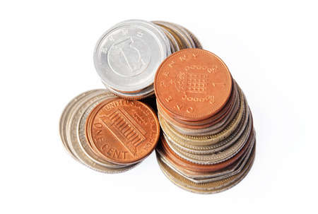 3 columns of coins - Pound Sterling, US dollars and Japanese Yen. Focus on the top of the Pound Sterling column.