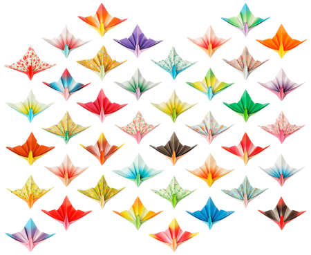Front view of 40 different paper cranes isolated on a white background.  Stock Photo