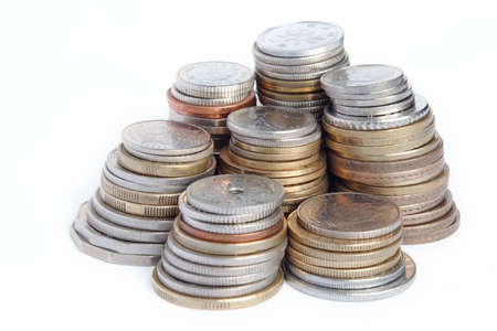7 columns of used coins including Australian Dollar and Japanese Yen on a white background  Stock Photo