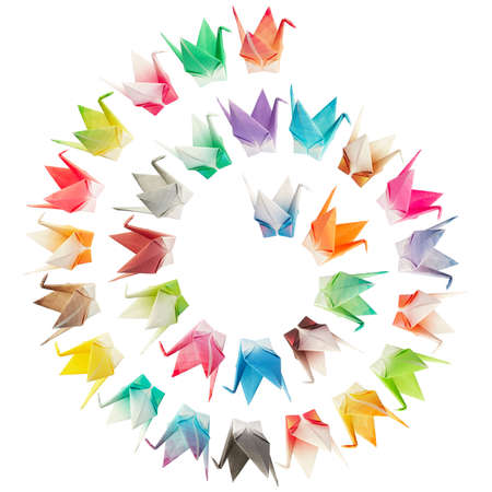 Paper folded birds arranged in a spiral shape and isolated on a white background