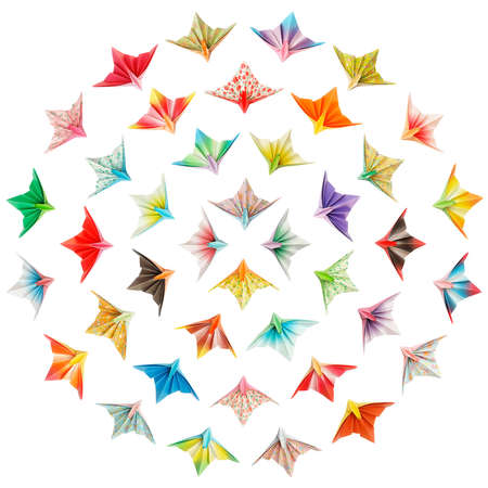 Paper birds arranged in circles and isolated on a white background  Stock Photo