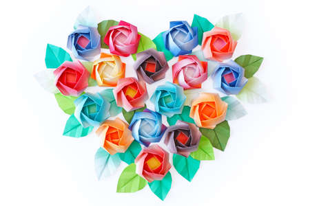 paper heart: Paper roses arranged in a heart shaped on a white background