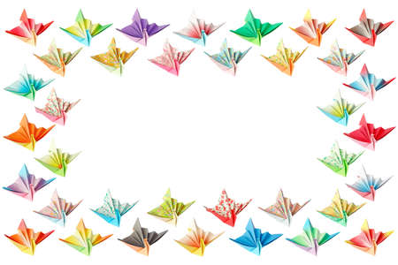 Colourful paper birds arranged as a rectangle frame and isolated on a white background