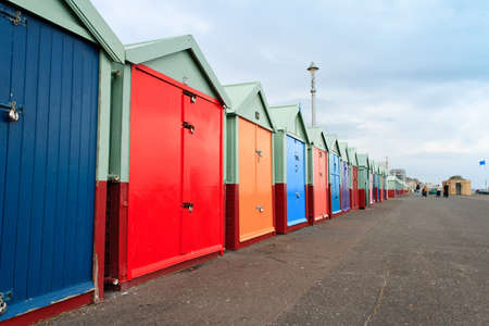 Colourful beach huts along Brighton Beach (Southern coast of Britain)