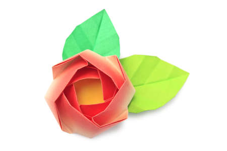 A red paper rose with two leaves on a white background