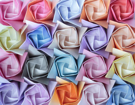 Top view of twenty colourful paper roses arranged as a decorative background  photo