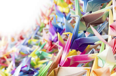 Colourful paper birds hanging together using fishing lines. Shallow depth of field.  photo
