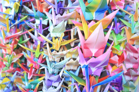 Colourful paper birds hanging together using fishing lines. Shallow depth of field.