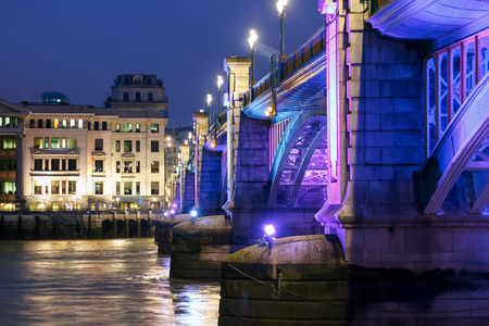 southwark: Southwark Bridge, London, illuminated at night Stock Photo