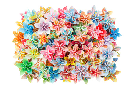 A rectangle pile of colourful paper flowers isolated on a white background Stock Photo