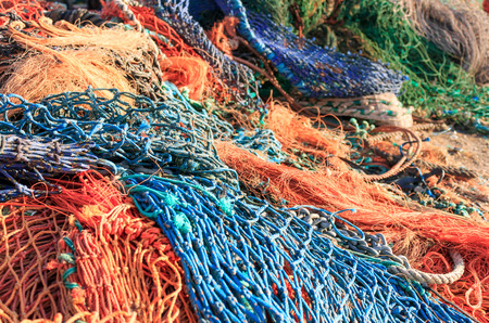 Close up of a pile of colourful fishing nets. Very shallow depth of field. Stock Photo