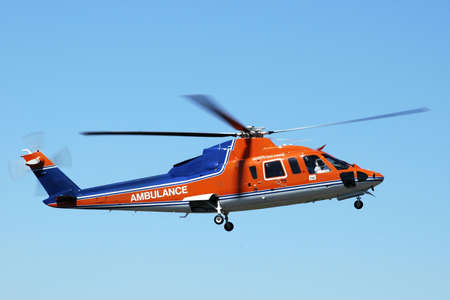 life saving: Air ambulance helicopter returning from a life saving mission