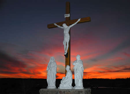 Crucifixion scene in front of colorfull sunset photo