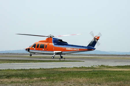 life saving: Air ambulance helicopter leaving for a life saving mission