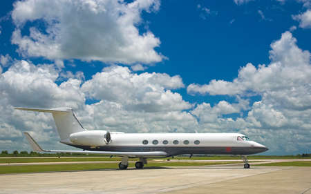 lear: Luxury business jet parked at exotic airport Stock Photo