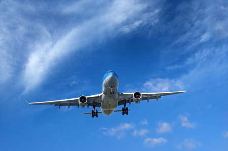 cirrus: Airliner on short final to landing under wispy clouds