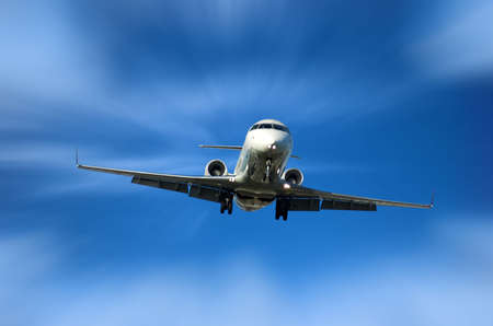 Corporate Jet fast approaching airport for landing photo