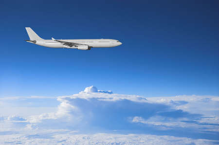 Jumbo jet flying high above a thunderstorm Stock Photo