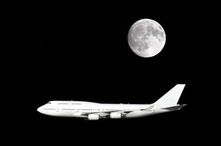 Large airliner flying under a full moon. Stock Photo - 2115705
