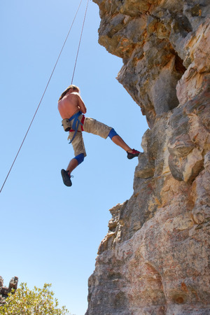 descends: Rock climber descends. Shot in Krakadouw, Cederberg Mountains, near Clanwilliam, Western Cape, South Africa.