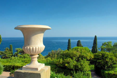 Vase on terrace against sea and mediterranean-style park. Shot in Vorontsov Dvorets, Alupka, Crimea, Ukraine.