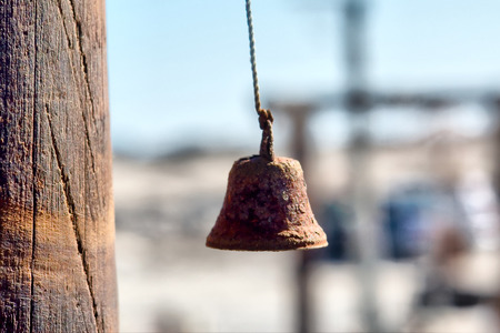 luderitz: Old rusty fishermans bell in sunset light. Shot in Luderitz, Diamond Coast, Namibia.