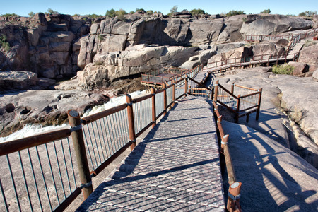northern cape: Wooden pathwalk next to the waterfall. Shot in Augrabies Waterfall, Northern Cape, South Africa.