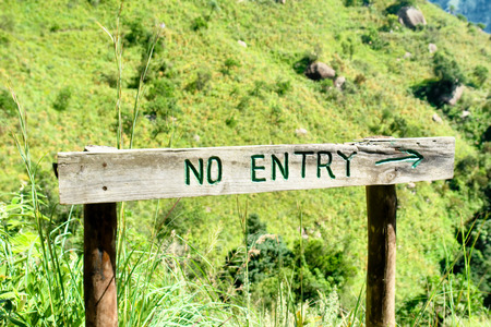cowl: No entry sign board. Shot in Monks Cowl nature reserve, Drakensberg Mountains, South Africa. Stock Photo