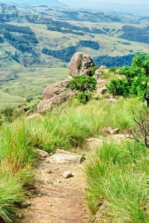 cowl: Sphinx rock from trail. Shot in Monks Cowl nature reserve, Drakensberg Mountains, South Africa.