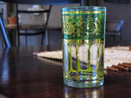 midlands: Vintage green glass on table. Shot in Midlands Meander area, Kwazulu-Natal, South Africa.