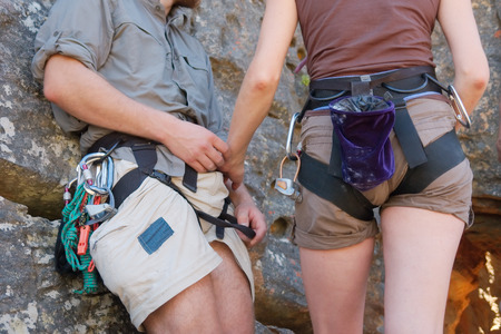 recreate: Rock climbers couple - closeup. Shot in Krakadouw, Cederberg Mountains, near Clanwilliam, Western Cape, South Africa.