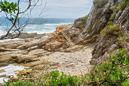 Rocky beach and ladder. Shot on the Otter trail in the Tsitsikamma National Park, Garden Route area, Western Cape, South Africa. photo