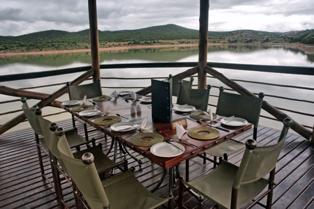 lodge: Table in the restaurant on lake. Shot near Oudtshoorn, Western Cape, South Africa.