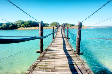 south coast: Old wooden bridge across the lagoon. Shot in the Die Mond nature reserve near Cape Town, Whale Coast, Western Cape, South Africa.