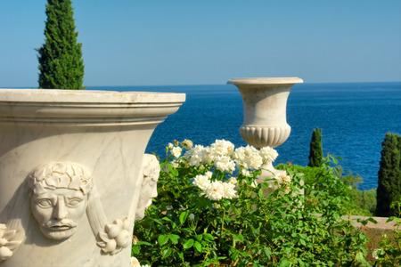alupka: Two antique vases in beautiful park next to sea. Shot in Vorontsov Dvorets, Alupka, Crimea, Ukraine.