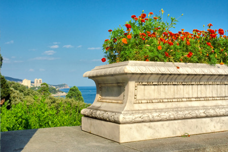 Flower pot on terrace against sea and mediterranean-type park. Shot in Vorontsov Dvorets, Alupka, Crimea, Ukraine.