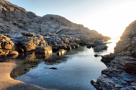 luderitz: Small rocky beach in morning light. Shot near Luderitz, Diamond Coast, Namibia. Stock Photo