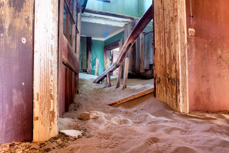 kolmanskop: Corridor inside the abandoned house in sand. Shot in a ghost town, Namibia. Stock Photo