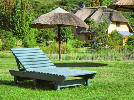kwazulu natal: Green lounger on lawn. Shot in Monks Cowl area, Drakensberg Mountains, South Africa.