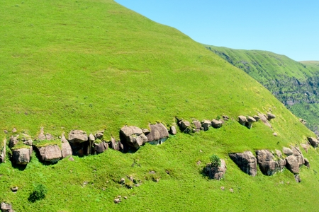 kwazulu natal: Grass-covered slope of a mountain. Shot in Monk Stock Photo