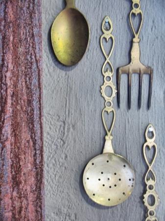 Vintage silverware on rustic wall. Shot in Midlands Meander area, Kwazulu-Natal, South Africa. photo