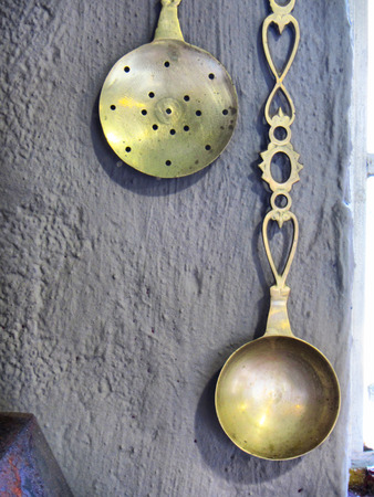 kwazulu natal: Vintage spoons on rustic wall. Shot in Midlands Meander area, Kwazulu-Natal, South Africa. Stock Photo