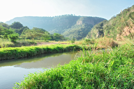 kwazulu natal: Sunny river and mountains. Shot in Shongweni Dam Nature Reserve, South Africa. Stock Photo